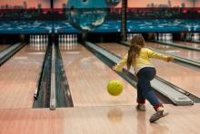 girl bowling stock image