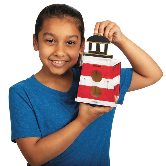 kid with lighthouse birdhouse