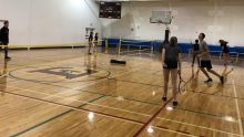 playing tennis featured pe